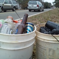 Two buckets of roadside trash on Ridge Road