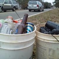 Two buckets of roadside trash on Ridge Road