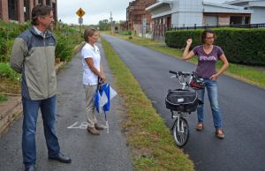 Sean Cusack, Beth Weisbrod and Juliellen Sarver speak to members of the media on the Virginia Capital Trail at Rocketts Landing, Sept. 29, 2015.