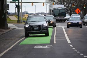 Cars driving in a buffered bike lane on 9th Street in downtown Richmond.